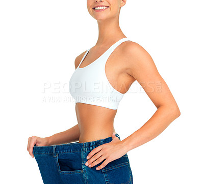 Buy stock photo Cropped shot of a sporty woman pulling her pants away from her body