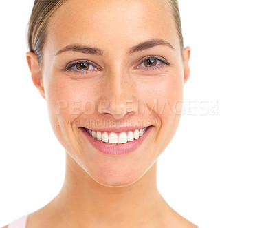 Buy stock photo Studio portrait of an attractive young woman smiling against a white background