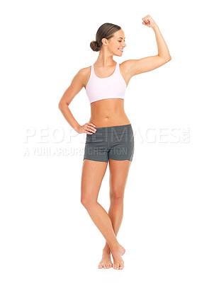 Buy stock photo Full length studio shot of a young woman flexing her bicep against a white background