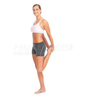 Buy stock photo Full length portrait of a sporty young woman stretching against a white background