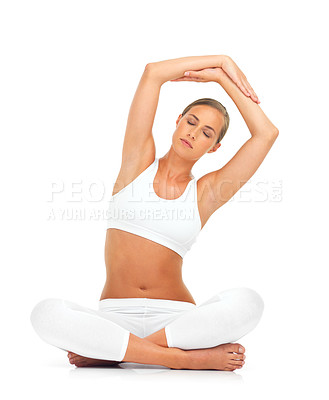Buy stock photo Shot of a young woman in a seated yoga pose