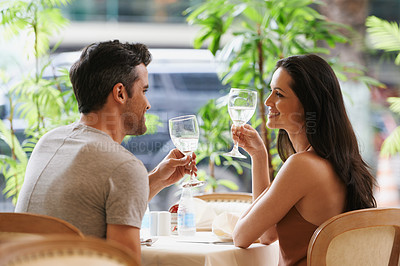 Buy stock photo A young couple in a restaurant