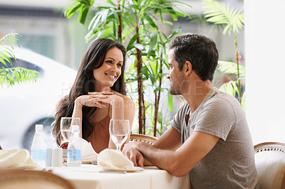 Buy stock photo A couple on a romantic date at a restaurant