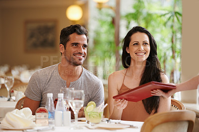 Buy stock photo A happy young couple on a date at a fancy restaurant