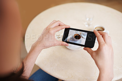 Buy stock photo Cropped shot of a person taking a photo of their espresso