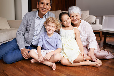 Buy stock photo Group shot of a brother and sister bonding with their grandparents