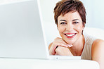Cheerful business woman with a laptop