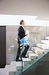 Business climbing up a flight of stairs
