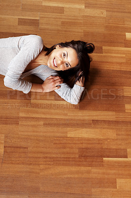 Buy stock photo Cute young woman relaxing on the floor