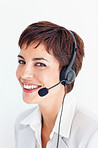 Beautiful receptionist with a headset smiling over white background