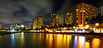 A nigh photo of Waikiki hotels and beach skylines
