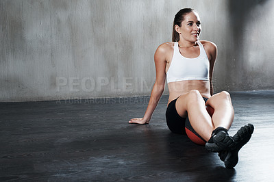 Buy stock photo Shot of a woman sitting with a medicine ball at the gym