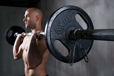 Buy stock photo Shot of a man working out with weights at the gym