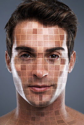 Buy stock photo Closeup studio portrait of a handsome young man with his face in mosaic