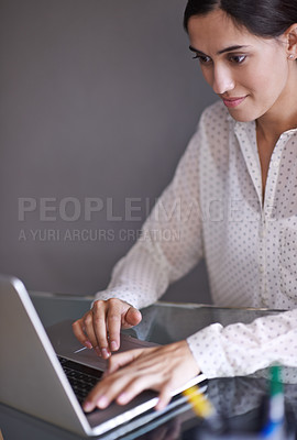 Buy stock photo Shot of a beautiful young woman working on her laptop from home