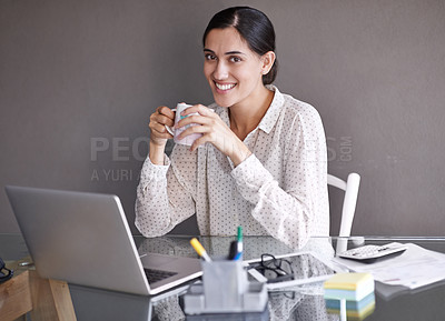 Buy stock photo Portrait of a beautiful young woman working on her laptop and enjoying a hot beverage