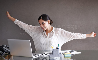 Buy stock photo Shot of a beautiful young woman celebrating at her laptop