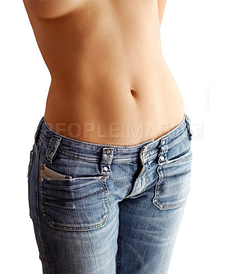 Buy stock photo Cropped image of a beautifully toned woman's stomach in jeans, isolated on white - copyspace