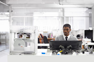 Buy stock photo Cropped shot of a young man printing his designs on a 3D printer