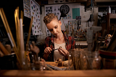 Buy stock photo A young woman working with tools at a wooden work station