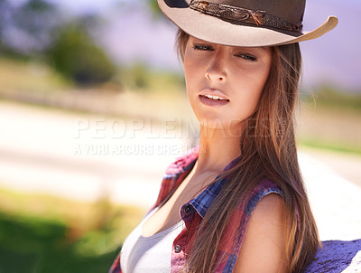 Buy stock photo A beautiful cowgirl standing outdoors