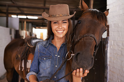 Buy stock photo Shot of a young woman tending to her horse