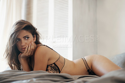 Buy stock photo Gorgeous brunette reclining on a bed