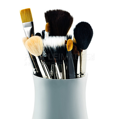 Buy stock photo A set of makeup brushes in their container, isolated on white
