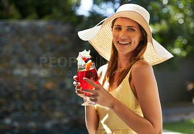 Buy stock photo A woman standing outdoors enjoying a cocktail