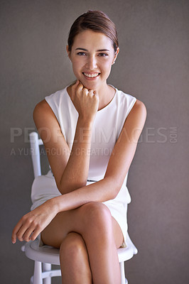 Buy stock photo Gorgeous businesswoman sitting on a chair