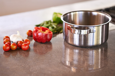 Buy stock photo Vegetables and a cooking pot on a kitchen counter