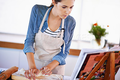 Buy stock photo A young woman baking bread