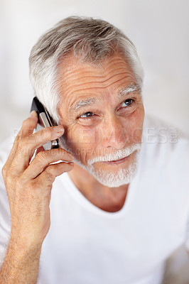 An old happy man speaking on a mobile