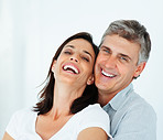 Closeup of a happy mature couple laughing together over a background