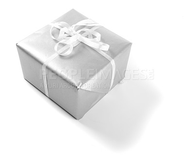 Buy stock photo Gift wrapped in silver paper with bow, isolated on white - copyspace