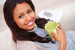 Top view of a beautiful smiling female with a cup