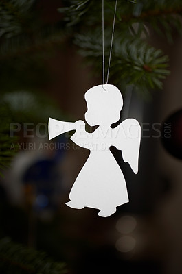 Buy stock photo Christmas decoration hanging from a tree branch - copyspace