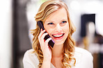 Closeup of a beautiful young woman speaking on a mobile phone