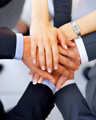 Buy stock photo Shot of a group of businesspeople standing in a huddle with their hands together