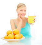 Blurred image of female offering orange juice over white background