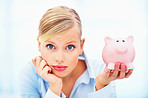 Closeup of blond woman holding a piggybank