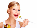 Portrait of smiling young female holding glass full of mixed fruits over white background