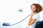 Happy business woman working in office, talking on the phone