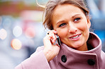 Closeup of a charming young lady talking on a cellphone