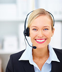Closeup portrait of a young receptionist using headset