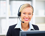 Smiling receptionist in work place using headset