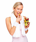 Healthy lifestyle - Fit young woman eating fruit
