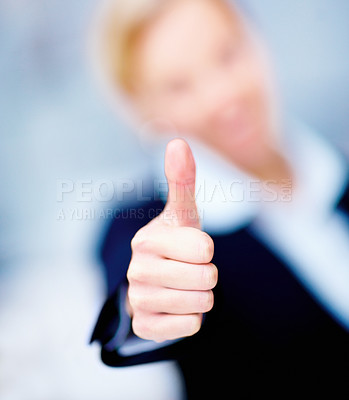 Success - macro of business persons thumbs up
