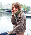 Portrait of a beautiful woman sitting talking on mobile phone