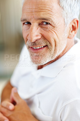 Buy stock photo Portrait of a happy elderly man smiling
